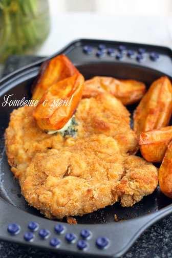 Шницели на фурна с пикантни картофи